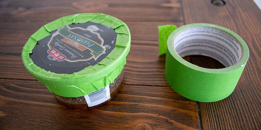 used grease container is taped around edges to prevent spillage