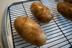 brined potatoes on baking rack