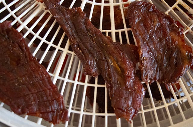fully cooked beef jerky on dehydrator tray