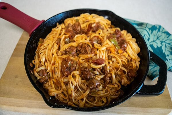 linguine with marinara sauce in cast iron skillet